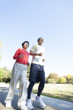 Senior couple jogging in the Park photo