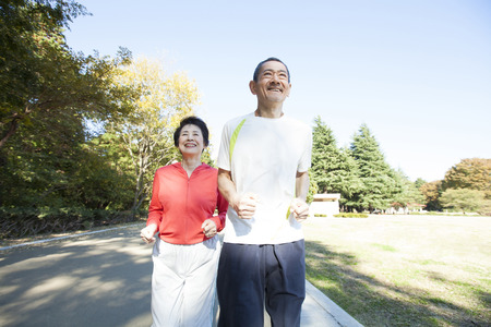 asian old lady: Senior couple jogging in the Park Stock Photo