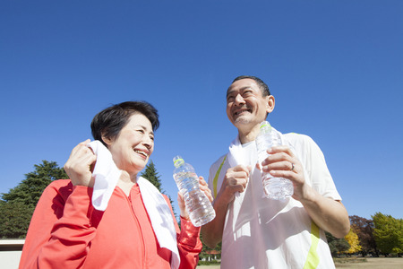 rehydration: Senior couple drinking water after exercise Stock Photo