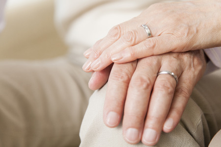 Senior couple of overlapping hands and hand