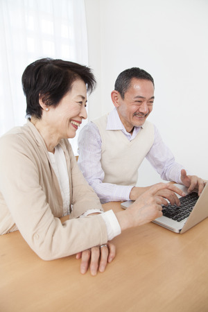 Senior couple working with laptop photo