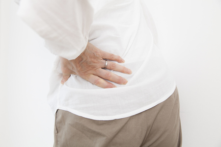 low back: Senior women who suffer from low back pain Stock Photo