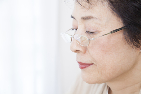 hyperopia: Senior women put the reading glasses