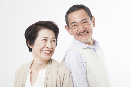 happy people white background: Senior couple gazing at Stock Photo