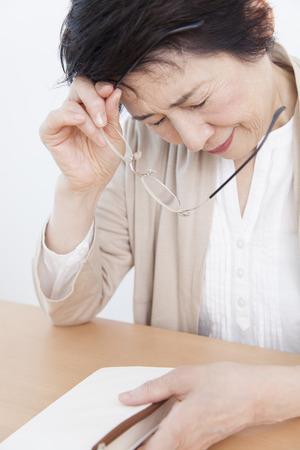 tiring: Senior women tiring reading