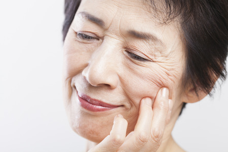 esthetic: Senior woman to worry about the wrinkles