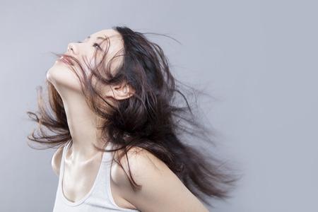 brandishing: Woman brandishing a hair