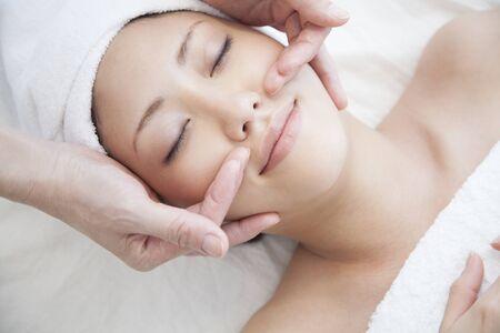 Women undergoing facial Este