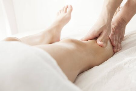 healing with sound: Legs of women undergoing Este