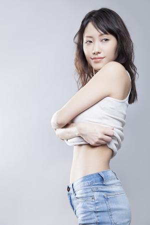 women undressing: Take off your shirt women Stock Photo