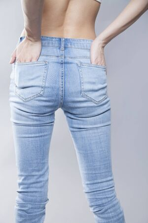 back shot: Back shot of a woman wearing a denim pants