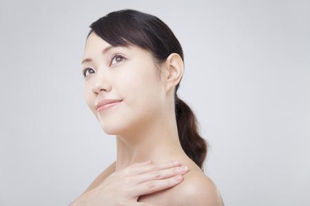 Women who show a neck Фото со стока