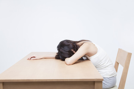 drowse: Women lie down on the table Stock Photo