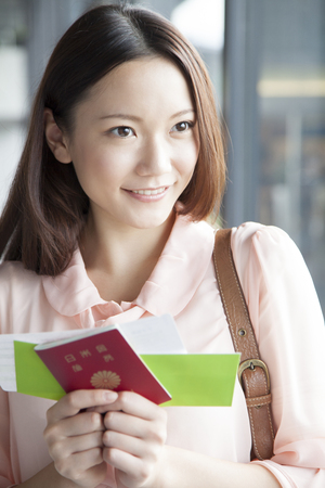 Smile, have your passport and ticket, women
