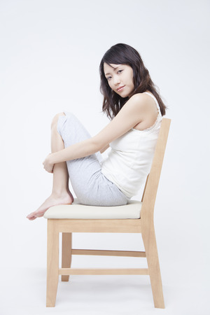 Women who suffer from leg on a chair 写真素材