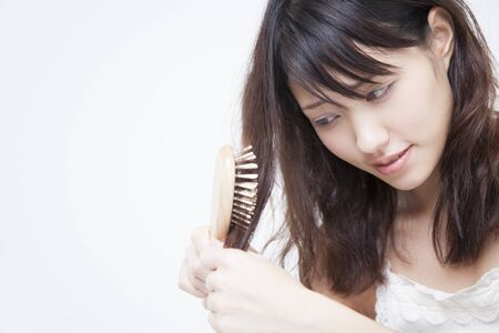 damaged: Woman to worry about the damaged hair Stock Photo