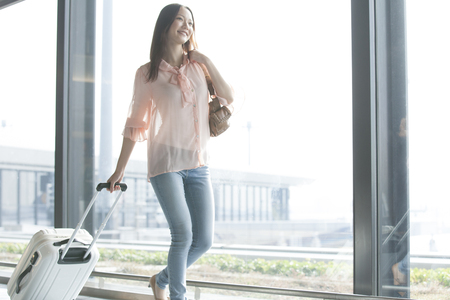 Woman walking by subtracting the suitcase