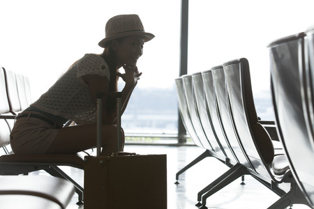 furlough: Woman sitting in a chair in the waiting lobby Stock Photo