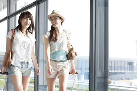 young asian couple: Women who walk the Airport Stock Photo