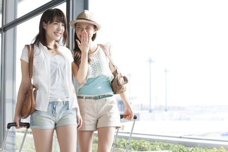 buddies: Women who walk the Airport Stock Photo