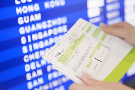 cronograma: Woman to check the timetable and the ticket of airplane