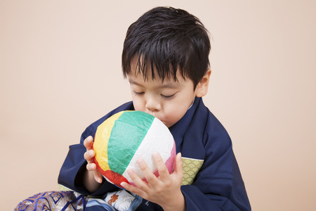 inflating: Boy inflating the paper balloon Stock Photo