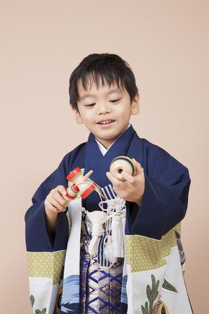 Boys playing in kendama Reklamní fotografie