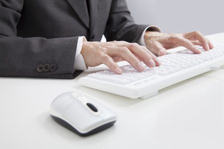 Businessman tapping a keyboard