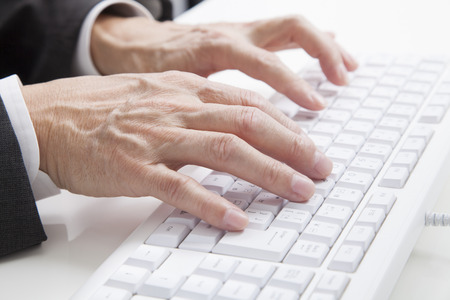 data entry: Hand of businessman tapping the keyboard Stock Photo
