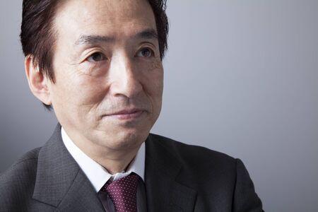 businessman suit: Smiling businessman Stock Photo