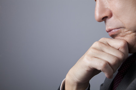 考えるビジネスマン 写真素材
