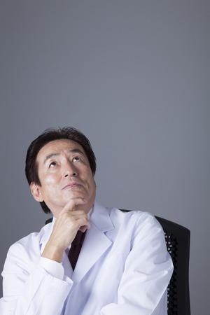 seasoned: Thoughtfully seasoned doctors Stock Photo