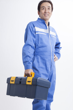 upgrading: Mechanic with tool box Stock Photo