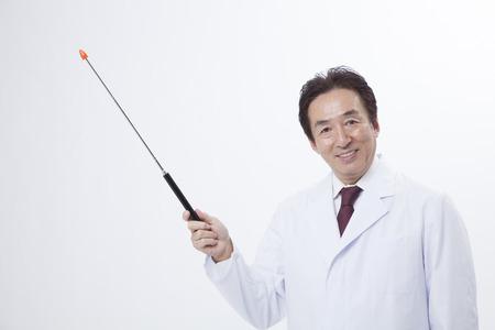 described: Veteran doctor described in pointing stick Stock Photo