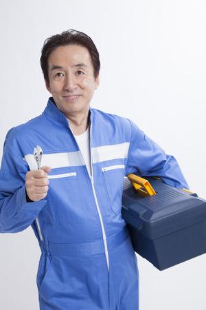 Mechanic with tool