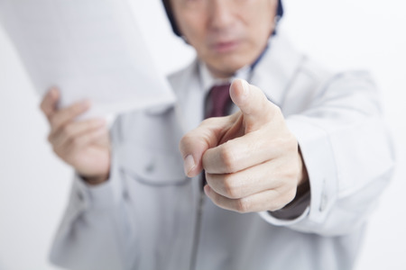 Site responsible for pointing the finger Standard-Bild