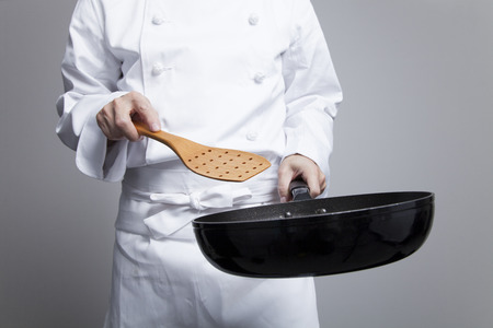 frying pan: Chef to cook in a frying pan Stock Photo