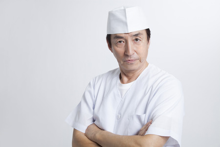 Chef to his arms folded