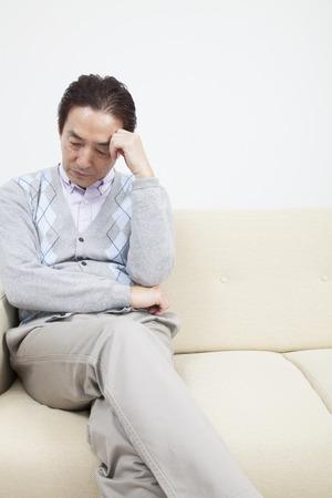 Mature man having headache