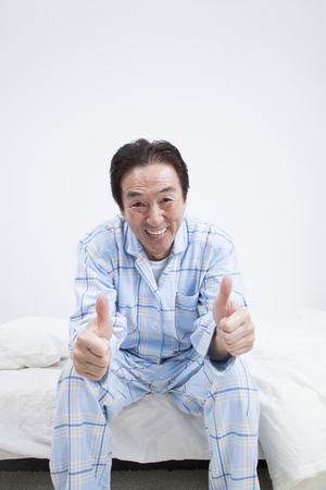 Middle men laugh sitting in bed