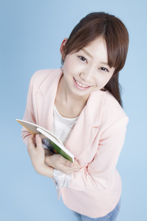 teaching material: Smiling female students have a text Stock Photo