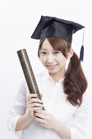 Female university students holding diplomas