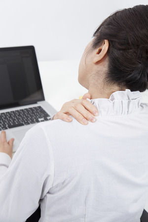 back rub: Back figure of business woman to rub shoulders Stock Photo