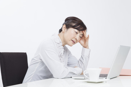 Business woman suffering from in front of the PC