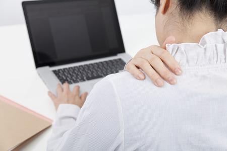 back rub: Back figure of business woman to rub shoulders Stock Photo