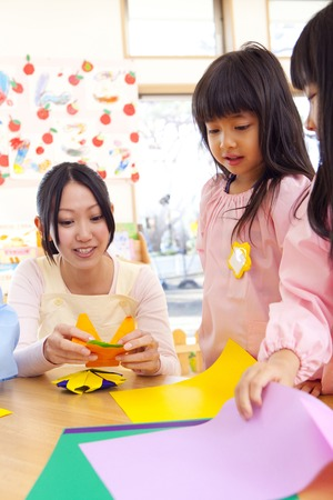 kindy: Kindergarten and kindergarten teachers folding origami Stock Photo