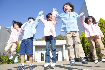 comrade: Kindergarten five smile to jump Stock Photo