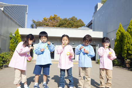 kindy: Kindergarten five people wipe the soap bubble Stock Photo