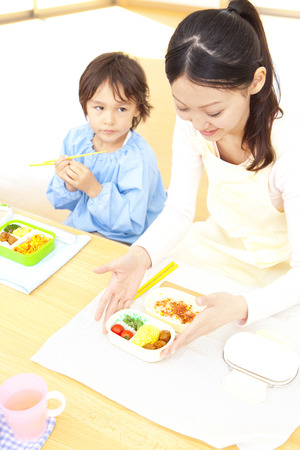 kindy: Kindergarten teachers and kindergarten boys eat your lunch Stock Photo