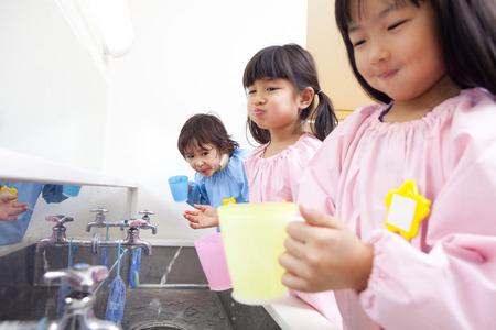 kindergartener: Kindergarten children to gargle Stock Photo